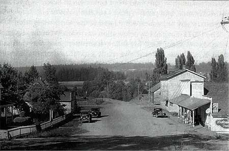 1938 photo looking north up Butte Street past the Butteville Store and Odd Fellows Hall. Note that the road down to the landing has become overgrown from disuse {Photo from Willamette Landings by Howard M. Corning]