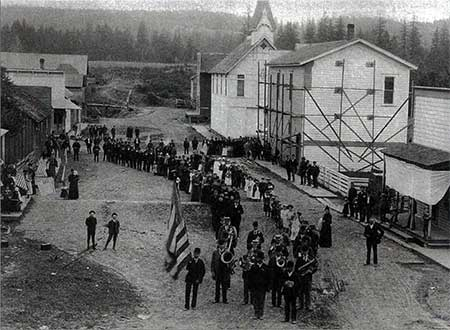 July 4th Parade at Butteville, 1904. Note Butte Road running past The Butteville Store, Odd Fellows Hall and Masonic Hall down to the river [Photo courtesy OPRD]